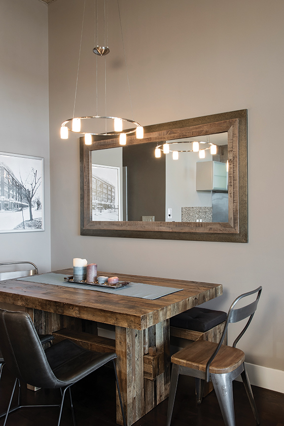 The Rustic Wood Dining Table Is Finished With A Mix Of Metal And Leather Chairs As Well Bench For Ample Seating If Homeowner Entertains