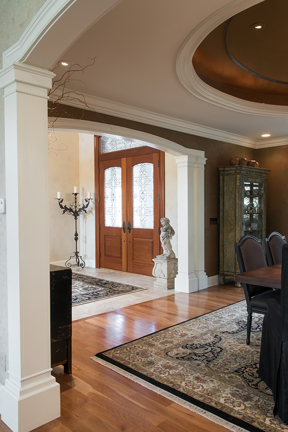 A Dramatic Wall And Ceiling Treatment Complements The Rich Fabrics Accent Pieces In Dining Room Entry Foyer Grand Candelabra From R Ege