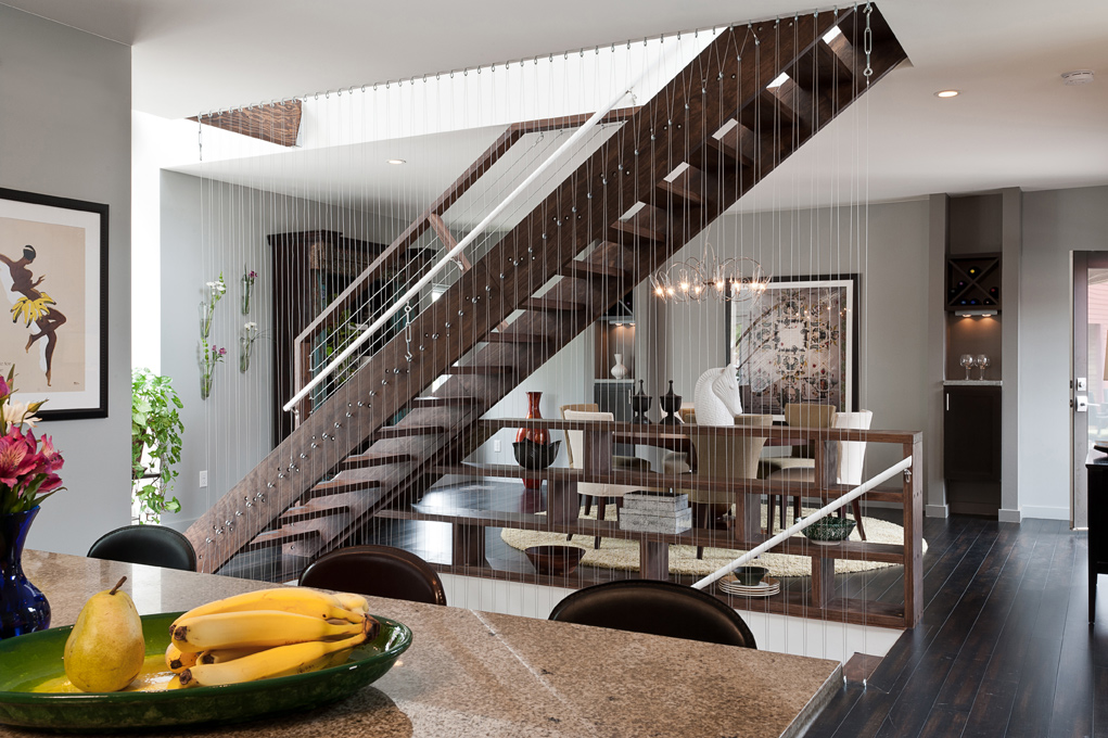The Suspension Wires Staircase Design Makes Transition Between Kitchen And Dining Room Seamless Does Not Impede Open Flow